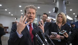 Sen. Rand Paul, R-Ky., complains to reporters that too many lawmakers, including him, are being kept out of a closed-door security briefing by CIA Director Gina Haspel on the slaying of Saudi journalist Jamal Khashoggi and involvement of the Saudi crown prince, Mohammed bin Salman, at the Capitol in Washington, Tuesday, Dec. 4, 2018. (AP Photo/J. Scott Applewhite)