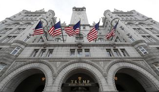 This Dec. 21, 2016, photo shows the Trump International Hotel at 1100 Pennsylvania Avenue NW, in Washington. The attorneys general of the District of Columbia and Maryland plan to file subpoenas seeking records from the Trump Organization, the IRS and other entities in their lawsuit accusing Donald Trump of profiting off the presidency. (AP Photo/Alex Brandon) **FILE**