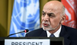 FILE - In this Nov. 28, 2018, file photo, Afghan president Ashraf Ghani talks during the United Nations Conference on Afghanistan at the UN Offices in Geneva, Switzerland. Ghani ordered Tuesday, Dec. 4, 2018, an investigation into allegations of sexual abuse of female athletes, saying that any kind of misconduct against athletes, male or female, was unacceptable. (Fabrice Coffrini/Pool Photo via AP, File)