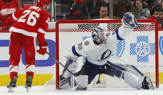 Tampa Bay Lightning goaltender Edward Pasquale (80) stops a Detroit Red Wings' Thomas Vanek (26) shot during a shootout in an NHL hockey game Tuesday, Dec. 4, 2018, in Detroit. (AP Photo/Paul Sancya)