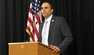 FILE - In this July 5, 2018, file photo, Maricopa County Sheriff Paul Penzone talks at anews conference in Phoenix. Penzone, who two years ago defeated longtime Sheriff Joe Arpaio, is making progress in carrying out a court-ordered overhaul of his agency after it was found to have racially profiled Latinos during his predecessor's traffic patrols that targeted immigrants. Still, the agency is not close to being released from the supervision of a federal judge and does not appear to have completely stomped out its problem with biased policing. (AP Photo/Jacques Billeaud, File)