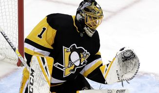 Pittsburgh Penguins goaltender Casey DeSmith gloves a shot during the first period of an NHL hockey game against the Colorado Avalanche in Pittsburgh, Tuesday, Dec. 4, 2018. (AP Photo/Gene J. Puskar)