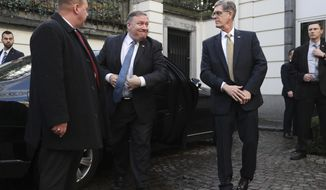 U.S. Secretary of State Mike Pompeo, second left, arrives for a meeting with Belgian Prime Minister Charles Michel in Brussels, Tuesday, Dec. 4, 2018. U.S. Secretary of State Mike Pompeo is in Brussels to attend a two-day meeting of NATO foreign ministers. (AP Photo/Francisco Seco, Pool)