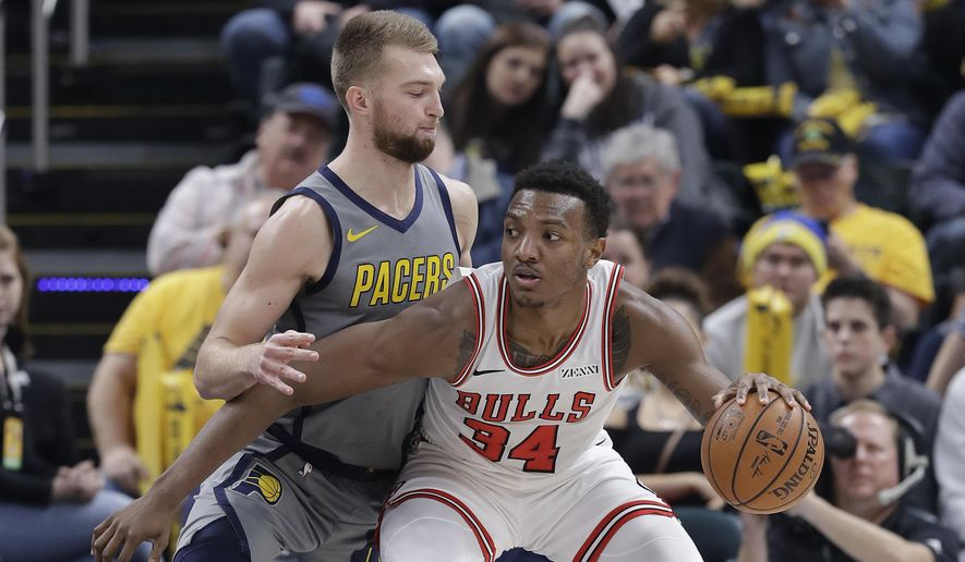 Chicago Bulls' Wendell Carter Jr. (34) is defended by Indiana Pacers' Domantas Sabonis during the first half of an NBA basketball game, Tuesday, Dec. 4, 2018, in Indianapolis. (AP Photo/Darron Cummings)