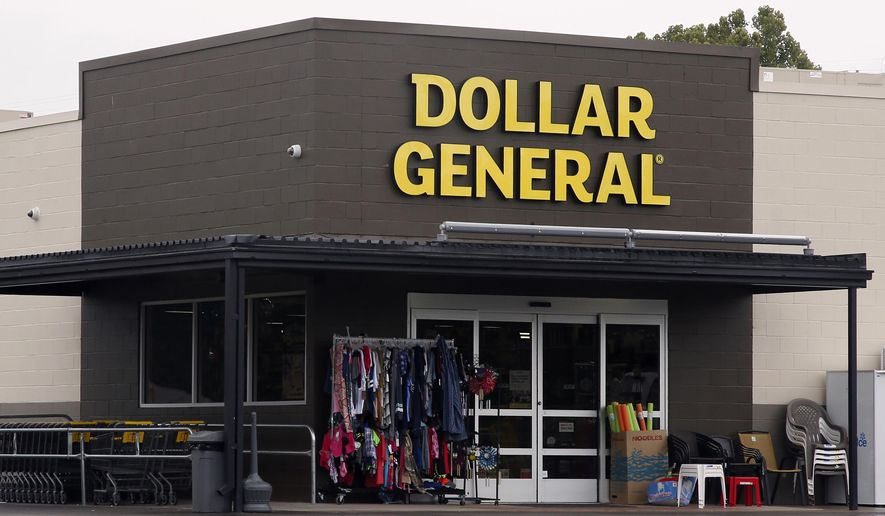 FILE- In this Aug. 3, 2017, file photo the Dollar General store is pictured in Luther, Okla. Dollar General reports earnings Tuesday, Dec. 4, 2018. (AP Photo/Sue Ogrocki, File)