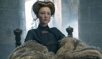 """This image released by Focus Features shows Saoirse Ronan as Mary Stuart in a scene from """"Mary Queen of Scots."""" (Liam Daniel/Focus Features via AP)"""