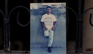 This Oct. 31, 2018 photo shows an undated family photo of Wilmer Gerardo Nunez as a young adult, at his mother's home in the Ciudad Planeta neighborhood of San Pedro Sula, Honduras. Eight years ago, at the age of 35, Nunez left Honduras for the United States, only to disappear in Mexico, leaving his anguished mother in limbo. (AP Photo/Moises Castillo)
