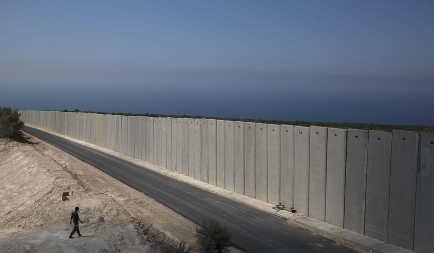 """FILE - In this Sept. 5, 2018 file photo, an Israeli soldier stands near a wall at the Israel Lebanon border near Rosh Haniqra, northern Israel. The Israeli military says it has launched an operation meant to """"expose and thwart"""" tunnels built by the Hezbollah militant group and stretching from Lebanon into northern Israel. (AP Photo/Sebastian Scheiner, File)"""