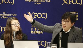 Lim Jae-sung, plaintiffs' attorney, speaks as Kim Se-eun, left, plaintiffs' attorney, listens during a press conference in Tokyo, Tuesday, Dec. 4, 2018. The two lawyers for Korean forced laborers demanded Nippon Steel & Sumitomo Metal Corp., a Japanese steelmaker, respond to their request to discuss compensation by Christmas, or they will take legal step to freeze its assets in their country. (AP Photo/Koji Sasahara)