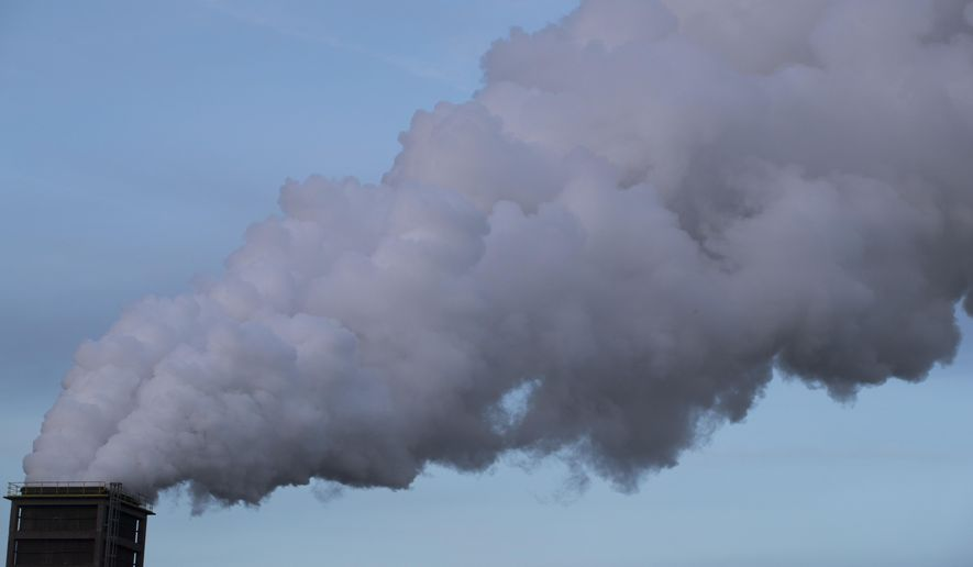 Smoke billows from a chimney in IJmuiden, Netherlands, Tuesday, Dec. 4, 2018. The climate change conference, COP24, takes place in Katowice, Poland, from Dec. 2-14, 2018. (AP Photo/Peter Dejong)