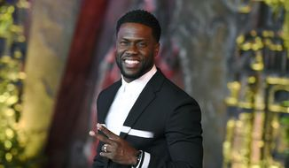 """In this Dec. 11, 2017, file photo, Kevin Hart arrives at the Los Angeles premiere of """"Jumanji: Welcome to the Jungle"""" in Los Angeles. Hart will host the 2019 Academy Awards, fulfilling a lifelong dream for the actor-comedian. Hart announced Tuesday, Dec. 4, 2018, his selection in an Instagram statement and the Academy of Motion Picture Arts and Sciences followed up with a tweet that welcomed him """"to the family."""" (Photo by Jordan Strauss/Invision/AP, File)"""