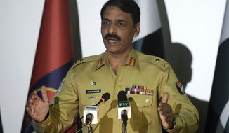 FILE - In this April 17, 2017, file photo, Pakistan's army spokesman Maj. Gen. Asif Ghafoor addresses a news conference in Rawalpindi, Pakistan. Ghafoor told a briefing of foreign journalists Tuesday, Dec. 4, 2018, that Pakistan's influence over the Taliban is overstated, yet he said Pakistan has repeatedly told the insurgent group to join the peace process. (AP Photo/Anjum Naveed, File)