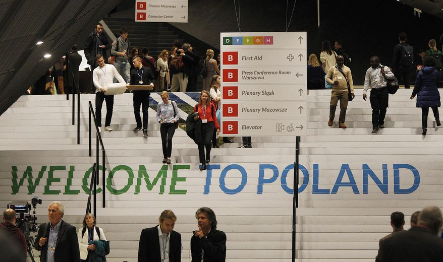 People walks down the stairs inside the venue of the COP24 U.N. Climate Change Conference 2018 in Katowice , Poland, Tuesday, Dec. 4, 2018.  The two-week meeting brings together diplomats and interested pressure groups from almost 200 countries to discuss the 2015 Paris Accord and other climate issues.  (AP Photo/Czarek Sokolowski)