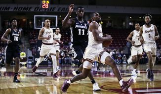 Boston College guard Wynston Tabbs, foreground, outruns Providence guard Alpha Diallo (11) on a drive to the basket during the first half of an NCAA college basketball game in Boston, Tuesday, Dec. 4, 2018. (AP Photo/Charles Krupa)