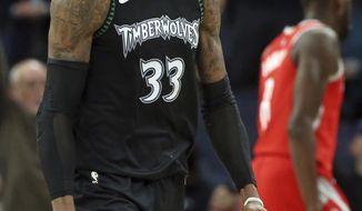 Minnesota Timberwolves' Robert Covington celebrates one of his baskets against the Houston Rockets in the second half half of an NBA basketball game Monday, Dec. 3, 2018, in Minneapolis. The Timberwolves won 103-91. (AP Photo/Jim Mone)