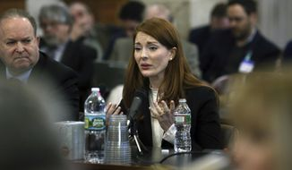 Katie Brennan, the chief of staff at the New Jersey Housing and Mortgage Finance Agency, answers a question as she testifies before the Select Oversight Committee at the Statehouse, Tuesday, Dec. 4, 2018, in Trenton, N.J. Brennan, who says Democratic Gov. Phil Murphy's campaign staff didn't take her sexual assault allegations seriously, has testified before the legislative oversight committee. (AP Photo/Mel Evans)