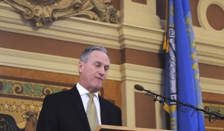 Gov. Dennis Daugaard gives the final budget address governor at the state Capitol in Pierre, S.D., Tuesday, Dec. 4, 2018. Daugaard is proposing spending increases for education, state employees and Medicaid providers in his plan. (AP Photo/James Nord)