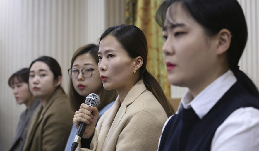 "FILE - In this Nov. 15, 2018 file photo, Kim Eun-jung, second from right, a member of South Korean Olympic women's curling team, speaks during a press conference in Seoul, South Korea. A beleaguered South Korean curling official on Tuesday, Dec. 4, 2018, said he and his family will leave the sport for good as the government investigates their alleged abusive treatment of the ""Garlic Girls,"" the country's hugely popular Olympic silver medalists. (AP Photo/Ahn Young-joon, File)"