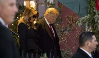 President Donald Trump and first lady Melania Trump leave Blair House after visiting with the family of former President George H. W. Bush, Tuesday, Dec. 4, 2018, in Washington. (AP Photo/Andrew Harnik)