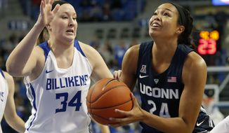 Connecticut's Napheesa Collier (24) heads to the basket as Saint Louis' Kendra Wilken (34) defends during the first half of an NCAA college basketball game Tuesday, Dec. 4, 2018, in St. Louis. (AP Photo/Jeff Roberson)