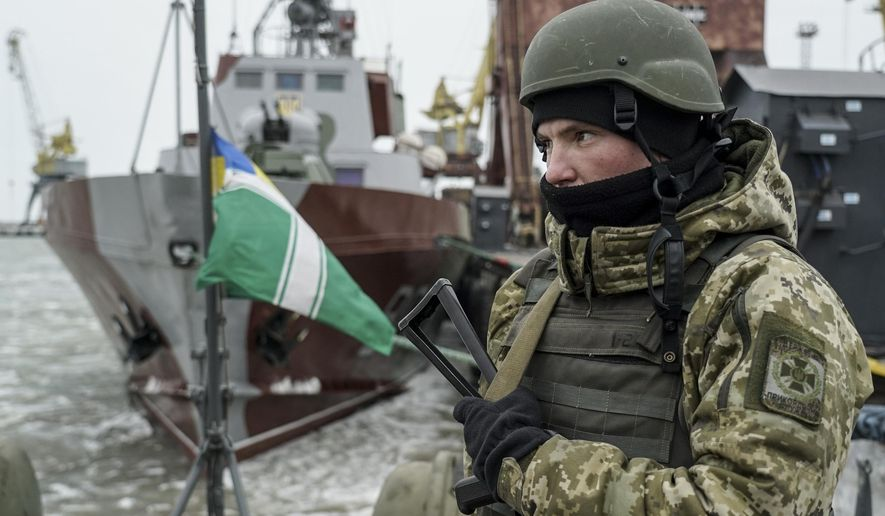 A Ukrainian serviceman stands on board a coast guard ship in the Sea of Azov port of Mariupol, eastern Ukraine, Monday, Dec. 3, 2018. The Ukrainian military has been on increased readiness as part of martial law introduced in the country in the wake of the Nov. 25, 2018, incident in the Sea of Azov, in which the Russian coast guard fired upon and seized three Ukrainian navy vessels along with their crews. (AP Photo/Evgeniy Maloletka) ** FILE **
