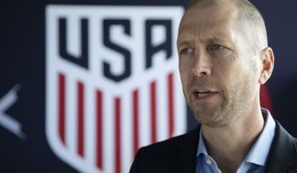 Gregg Berhalter, the recently-named head coach of the U.S. men's national soccer team, speak at a news conference, Tuesday, Dec. 4, 2018, in New York. (AP Photo/Mark Lennihan)