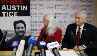Marc and Debra Tice, the parents of Austin Tice, who is missing in Syria for nearly six years, speak during a press conference, at the Press Club, in Beirut, Lebanon, Tuesday, Dec. 4, 2018. They say they are hopeful the Trump administration will work on releasing their son the way they did with Americans who had been held for long time in North Korea. (AP Photo/Bilal Hussein)