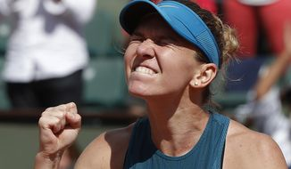 Romania's Simona Halep clenches her fist after defeating Spain's Garbine Muguruza during their semifinal match at the French Open tennis tournament in Paris on June 7, 2018. Halep won 6-1, 6-4. (AP Photo/Michel Euler)