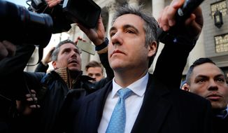"""Michael Cohen has pleaded guilty to lying to Congress about work he did on an aborted project to build a Trump Tower in Russia. He told a judge he lied about the timing of the negotiations and other details to align with Trump's """"political message."""" (Associated Press/File)"""