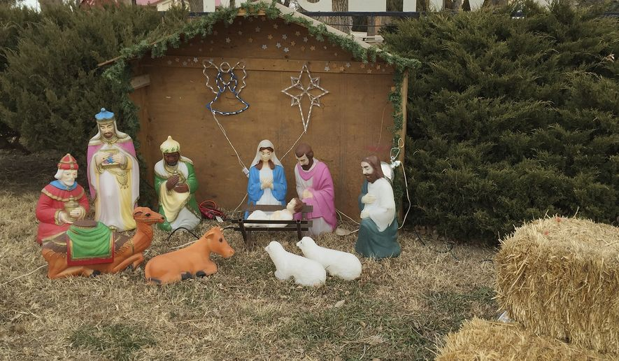 In this Dec. 27, 2015, file photo, a Nativity scene is displayed next to a public park in the farming community of McClave, Colo. (AP Photo/Russell Contreras) ** FILE **