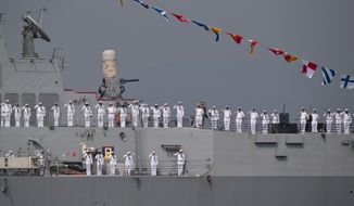 U.S. sailors on USS McCampbell, an Arleigh Burke-class destroyer, salute the Indian President Pranab Mukherjee, during the International Fleet Review in Vishakapatnam, India, Saturday, Feb. 6, 2016. Mukherjee, who is the supreme commander of the Indian armed forces, reviewed a fleet of over 90 naval ships including several from foreign countries.  (AP Photo/Saurabh Das)