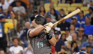 FILE - In this Aug. 31, 2018 file photo Arizona Diamondbacks' Paul Goldschmidt hits a two-run home run during the first inning of a baseball game against the Los Angeles Dodgers in Los Angeles. The St. Louis Cardinals have acquired Goldschmidt from the Diamondbacks in a multiplayer trade. The Cardinals sent pitcher Luke Weaver, catcher Carson Kelly, minor league infielder Andy Young and a 2019 draft pick to Arizona in the deal Wednesday, Dec. 5, 2018. (AP Photo/Mark J. Terrill) **FILE**