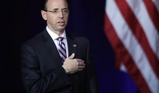 Deputy Attorney General Rod J. Rosenstein stands during opening ceremonies at the Project Safe Neighborhoods National Conference in Kansas City, Mo., Wednesday, Dec. 5, 2018. (AP Photo/Orlin Wagner)
