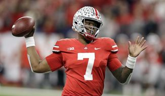 FILE - This Dec. 1, 2018, file photo shows Ohio State quarterback Dwayne Haskins (7) throwing during the first half of the Big Ten championship NCAA college football game against Northwestern, in Indianapolis. Haskins is the offensive player of the year and Michigan linebacker Devin Bush is defensive player of the year on The Associated Press All-Big Ten Conference team released Wednesday, Dec. 5, 2018. (AP Photo/Darron Cummings) ** FILE **