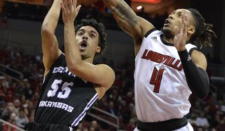 Louisville guard Khwan Fore (4) attempts to block the shot of Central Arkansas guard DeAndre Jones (55) during the first half of an NCAA college basketball game, in Louisville, Ky., Wednesday, Dec. 5, 2018. (AP Photo/Timothy D. Easley)