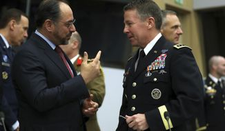 Resolute Support Mission Commander United States Army General Austin Scott Miller, right, speaks with Afghanistan's Foreign Minister Salahuddin Rabbani during a meeting of the North Atlantic Council and Resolute Support at NATO headquarters in Brussels, Wednesday, Dec. 5, 2018. (AP Photo/Francisco Seco, Pool)