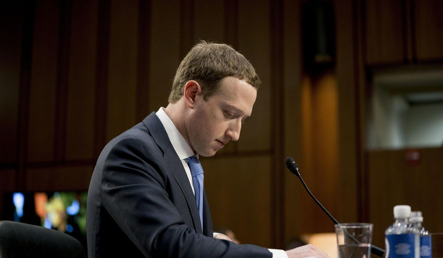 In this April 10, 2018, file photo Facebook CEO Mark Zuckerberg pauses while testifying before a joint hearing of the Commerce and Judiciary Committees on Capitol Hill in Washington about the use of Facebook data to target American voters in the 2016 election. The British Parliament has released some 250 pages worth of documents that show Facebook considered charging developers for data access. The documents show internal discussions about linking data to revenue. (AP Photo/Andrew Harnik, File)