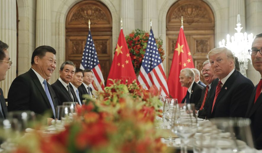 In this Dec. 1, 2018, photo, President Donald Trump, second from right, meets with China's President Xi Jinping, second from left, during their bilateral meeting at the G20 Summit, in Buenos Aires, Argentina. China promised Wednesday, Dec. 5, 2018, to carry out a tariff cease-fire with Washington but gave no details that might help dispel confusion about what Presidents Xi and Trump agreed to in Argentina.(AP Photo/Pablo Martinez Monsivais, File) **FILE**