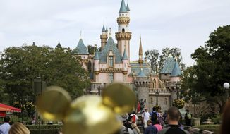FILE - In this Jan. 22, 2015, file photo, visitors walk toward Sleeping Beauty's Castle in the background at Disneyland Resort in Anaheim, Calif. A health official testified that a cooling tower that provides mist to make Disneyland visitors comfortable was the likely source for 22 cases in a Legionnaires' disease outbreak in 2017 near the theme park. Dr. Matthew Zahn with the Orange County Health Care Agency testified Tuesday, Dec. 4, 2018, before an appeals board judge at the California Occupational Safety and Health Administration. (AP Photo/Jae C. Hong, File)