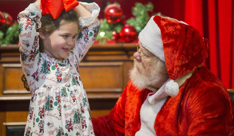 Larry Bennett, as Santa Claus, talks with Emma McClanhan about what she wants for Christmas during the Breakfast with Santa on Saturday, December 1, 2018 at the Longview Museum of Fine Art in Longview. (Courtney Case/The News-Journal via AP)