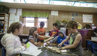 In this Thursday, Nov. 29, 2018, photo, students work on projects in Carrie Baker's classroom at Canyon Lake Elementary School in Rapid City, S.D. (Ryan Hermens/Rapid City Journal via AP)
