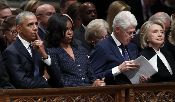 Former President Barack Obama, Michelle Obama, former President Bill Clinton and former Secretary of State Hillary Clinton listen during the State Funeral for former President George H.W. Bush at the National Cathedral, Wednesday, Dec. 5, 2018, in Washington. (AP Photo/Alex Brandon, Pool) ** FILE **