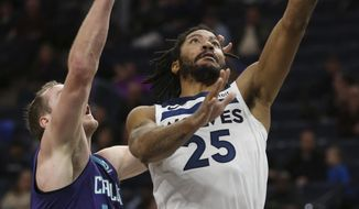 Minnesota Timberwolves' Derrick Rose (25) shoots the ball against Charlotte Hornets' Cody Zeller (40) in the first half of an NBA basketball game Wednesday, Dec. 5, 2018, in Minneapolis. (AP Photo/Stacy Bengs)