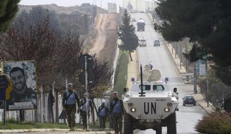 "Serbian U.N peacekeepers patrol the Lebanese side of the Lebanese-Israeli border in the southern village of Kfar Kila, Lebanon, Tuesday, Dec. 4, 2018. The Israeli military launched an operation on Tuesday to ""expose and thwart"" tunnels it says were built by the Hezbollah militant group that stretch from Lebanon into northern Israel. (AP Photo/Mohammed Zaatari)"