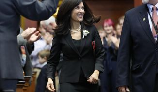 Sara Gideon, D-Freeport, arrives in the House Chamber after being re-elected Speaker of the House, Wednesday, Dec., 5, 2018, at the State House in Augusta, Maine. (AP Photo/Robert F. Bukaty)