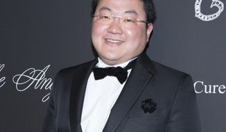 FILE - In this Oct. 20, 2014 file photo, Jho Low attends the 2014 Angel Ball, hosted by Gabrielle's Angel Foundation, at Cipriani Wall Street in New York. Malaysian police said Wednesday, Dec. 5, 2018, that they have filed new criminal charges against fugitive financier Low Taek Jho and four others over the multibillion-dollar looting of state investment fund 1MDB. Low is wanted for his alleged role as the mastermind in a massive money laundering and bribery scheme that pilfered billions of dollars from the indebted 1MDB fund. (Photo by Scott Roth/Invision/AP, File)