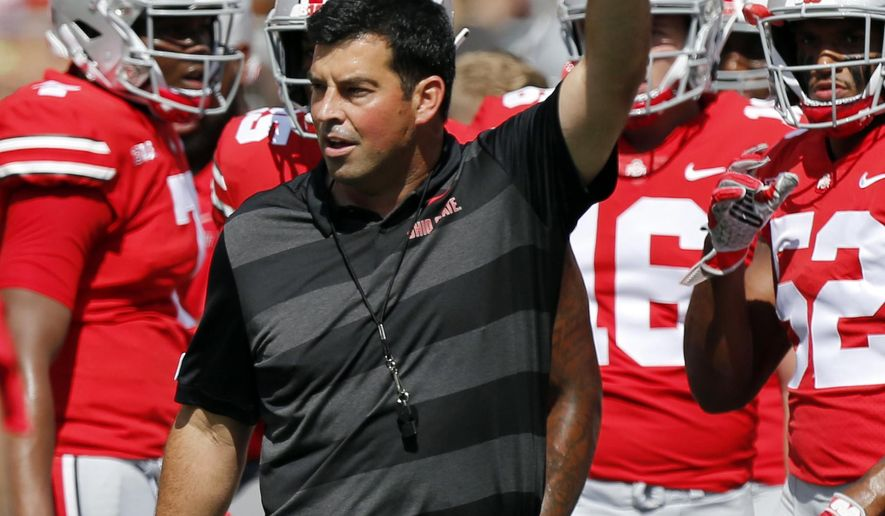 FILE - In this Saturday, Sept. 1, 2018, file photo, Ohio State's acting head coach Ryan Day directs warm-ups before an NCAA college football game against Oregon State, in Columbus, Ohio. Ohio State says Urban Meyer will retire after the Rose Bowl and assistant Ryan Day will be the next head coach. After seven years and a national championship at Ohio State, the 54-year-old Meyer will formally announce his departure Tuesday, Dec. 4, 2018, at a news conference. (AP Photo/Jay LaPrete, File)