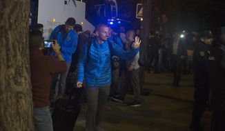 Boca Juniors players arrive at their hotel in Madrid, Spain, Wednesday, Dec. 5, 2018. The Copa Libertadores Final will be played on Dec. 9 in Spain at Real Madrid's stadium for security reasons after River Plate fans attacked the Boca Junior team bus heading into the Buenos Aires stadium for the meeting of Argentina's fiercest soccer rivals last Saturday. (AP Photo/Paul White)