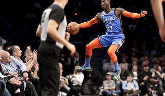 Oklahoma City Thunder guard Dennis Schroder fails to keep the ball in bounds during the first half of an NBA basketball game against the Brooklyn Nets, Wednesday, Dec. 5, 2018, in New York. (AP Photo/Julio Cortez)