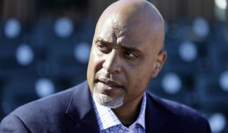 FILE - In this March 17, 2015, file photo, Major League Baseball Players Association executive director Tony Clark talks to the media before a spring training exhibition baseball game in Lakeland, Fla. Baseball players are concerned the Seattle Mariners have become yet another rebuilding team and may be joined by others. Union head Tony Clark and new collective bargaining director Bruce Meyer said Wednesday, Dec. 5, 2018 their members also are concerned about rapid change in the way games are played, such as the increased use of relief pitchers, and are willing to speak with management this offseason about whether counteracting changes are needed.(AP Photo/Carlos Osorio, File)